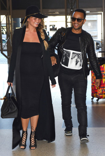 ** RESTRICTIONS: WORLDWIDE EXCEPT IN MONACO, SCOTLAND, UNITED KINGDOM ** Los Angeles, CA - **NO UK** Los Angeles, CA - Chrissy Teigen seems over the moon when it comes to being a expectant new mum. The model is all smiles with husband John Legend as they head off through LAX airport bound for a romantic holiday in Paris, France. Chrissy is seen rocking a super tight slinky black dress that accentuates her growing baby bump. Chrissy and John only just flew back into town yesterday from Hawaii but obviously want to get as much travel in as possible before Chrissy can't fly anymore.   12/25/2015  Copyright © 2014 AKM-GSI, Inc.      To License These Photos, Please Contact :  Maria Buda  (917) 242-1505  mbuda@akmgsi.com or    Steve Ginsburg  (310) 505-8447  (323) 423-9397  steve@akmgsi.com  sales@akmgsi.com