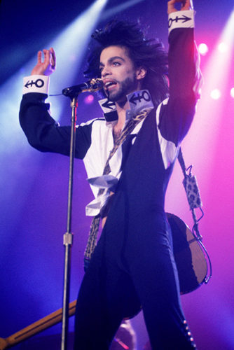 American singer and songwriter Prince performs in concert, singing with a guitar strapped behind his back, Wembley Arena, London, England, July 1990. (Photo by Frank Micelotta/Getty Images)