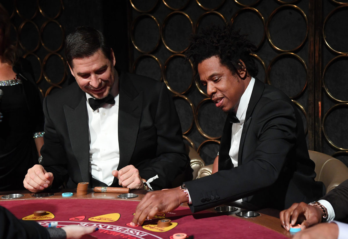 Jay-Z playing baccarat with guests at the Inaugural Shawn Carter Foundation Gala