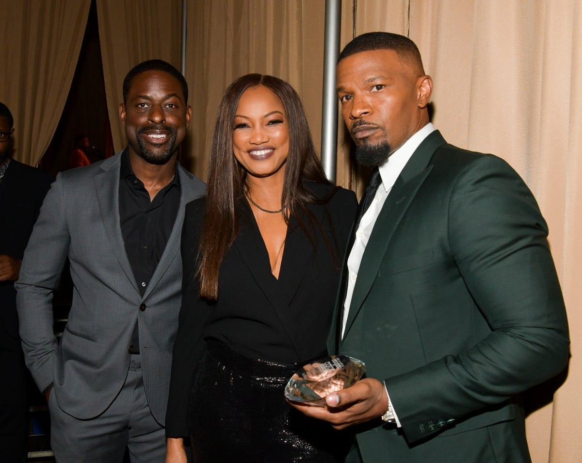 Sterling K. Brown, Garcelle Beauvais, and Jamie Foxx at African American Film Critics Association Awards